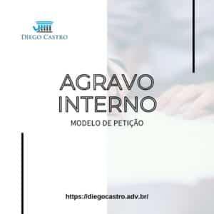 modelo de petição de agravo interno com foto no fundo de documento sendo assinado